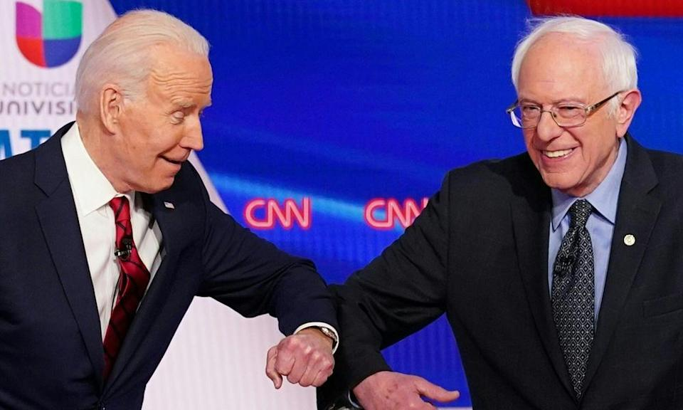 Joe Biden and Bernie Sanders greet each other with a safe elbow bump before the start of the 11th Democratic presidential debate on 15 March 2020.
