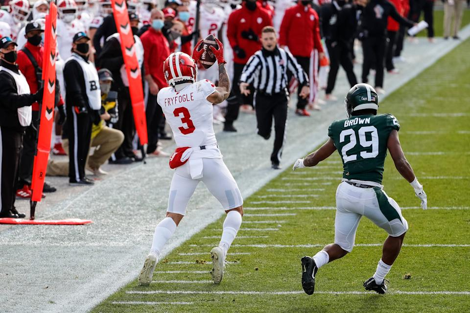 Indiana wide receiver Ty Fryfogle makes a catch behind Michigan State cornerback Shakur Brown during the first half at Spartan Stadium in East Lansing, Saturday, Nov. 14, 2020.