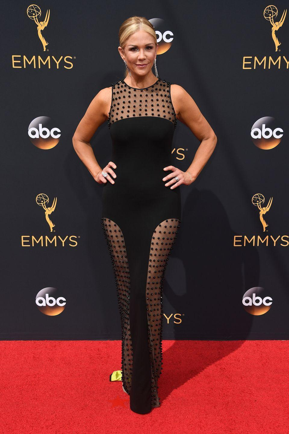 <p>The TV personality took on a different kind of thigh-high slit in this sheer-panelled gown. </p>