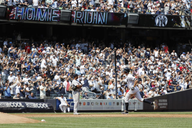 New York Yankees DJ LeMahieu rounds the bases after hitting a three-run home run against the Boston Red Sox in the fourth inning of a baseball game, Saturday, Aug. 3, 2019, in New York. New York Yankees Breyvic Valera and New York Yankees Brett Gardner scored. (AP Photo/Michael Owens)