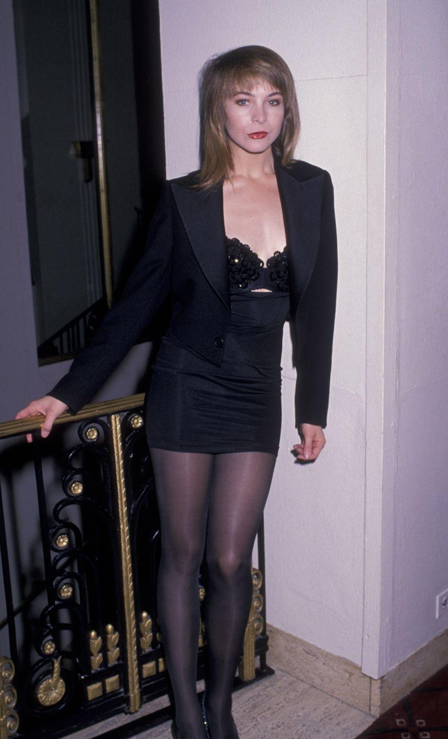 <p>Coleman stunned in a black suit-top with sequined bra and miniskirt.</p>