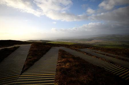 "Zig-zag steps lead up to the prehistoric stone fort of Grianan of Aileach where you can view the border between Ireland and Northern Ireland, seen from near the border village of Speenogue, Ireland, February 1, 2018. REUTERS/Clodagh Kilcoyne  SEARCH ""KILCOYNE BORDER"" FOR THIS STORY. SEARCH ""WIDER IMAGE"" FOR ALL STORIES. - RC1796E4AE60"