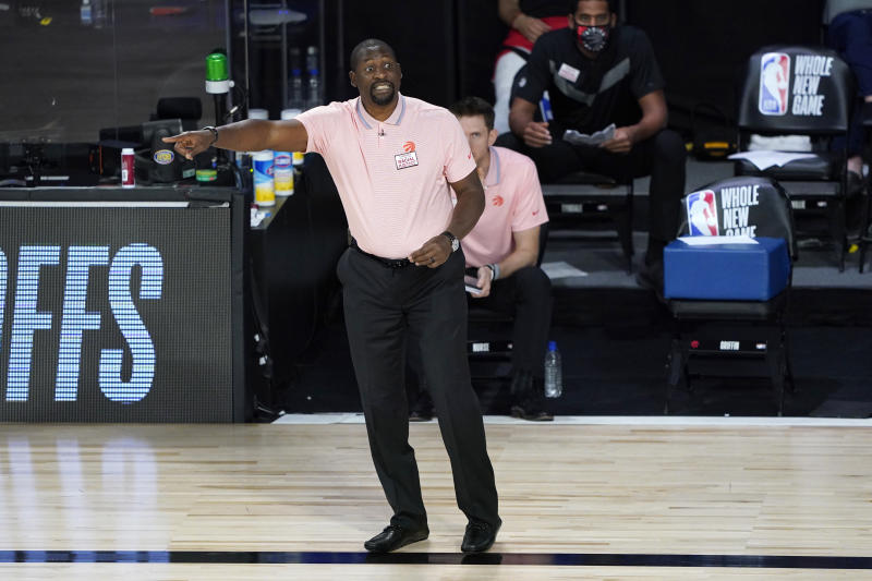 Toronto Raptors assistant coach Adrian Griffin reacts during the second half of an NBA basketball game while leading the team after head coach Nick Nurse stepped down for a the night to let Griffin coach against the Philadelphia 76ers Wednesday, Aug. 12, 2020 in Lake Buena Vista, Fla. (AP Photo/Ashley Landis, Pool)