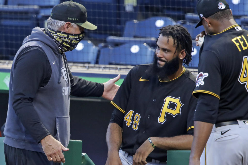 Pittsburgh Pirates manager Derek Shelton, left, talks with pitchers Richard Rodriguez (48) and Michael Feliz (45) between innings of an intrasquad game during the team's baseball practice at PNC Park in Pittsburgh, Wednesday, July 15, 2020. The Pirates first-year manager is a mix of old-school grit and new-school analytics nerd. The club also believes he's a breath of fresh air for a franchise in need of a jolt. (AP Photo/Gene J. Puskar)