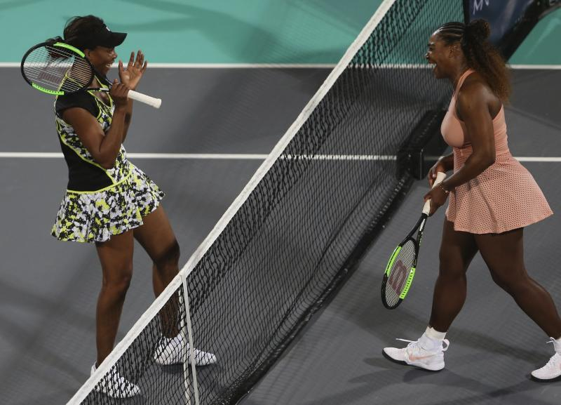 Venus Williams, left, from the U.S., celebrates after defeating her sister, Serena, in a match during the opening day of the Mubadala World Tennis Championship in Abu Dhabi, United Arab Emirates, Thursday, Dec. 27, 2018. (AP Photo/Kamran Jebreili)