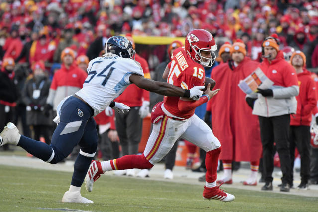 Kansas City Chiefs' Patrick Mahomes runs for a touchdown past Tennessee Titans linebacker Rashaan Evans (54) during the first half of the NFL AFC Championship football game Sunday, Jan. 19, 2020, in Kansas City, MO. (AP Photo/Ed Zurga)