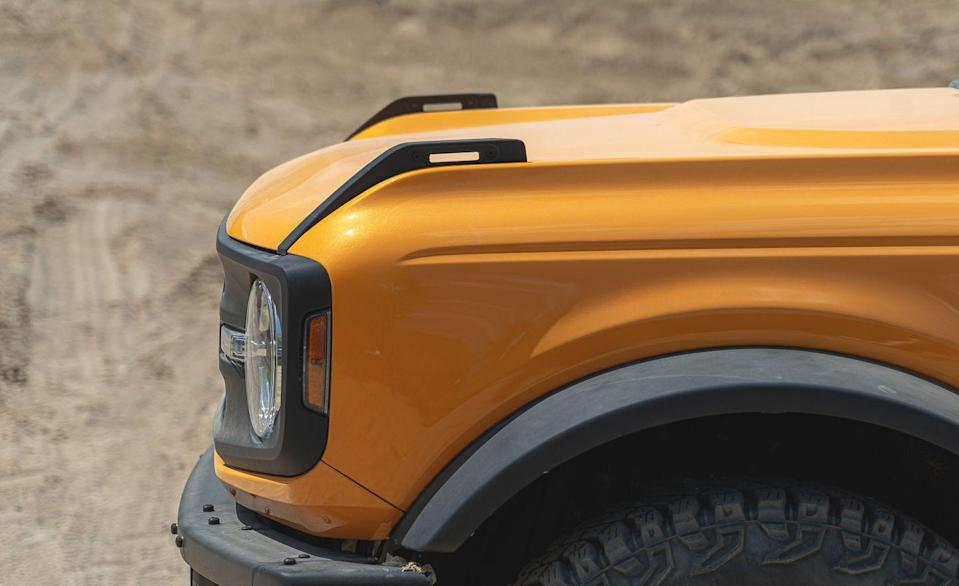 <p>Reminiscent of the first-generation Bronco's tall pointy fenders, the new Ford Bronco incorporates the old look with what it calls Trail Sights. They're tie-downs you can strap stuff to, for instance ORV flags, windshield cables, or even high-lift jacks. These tie-downs are limited to 150 pounds, so don't go using them as recovery points for getting pulled out of the mud. Unless you want to end up on YouTube.</p>