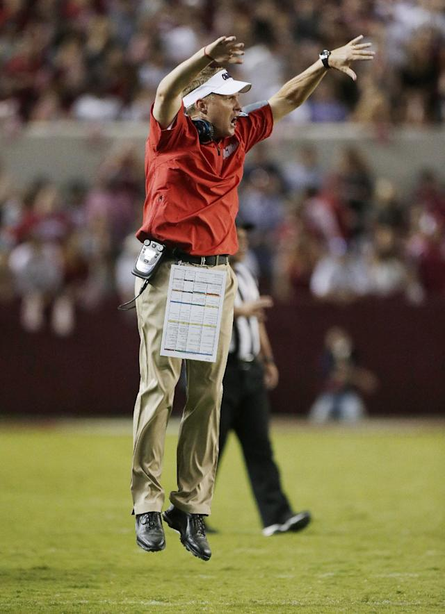 Mississippi coach Hugh Freeze jumps after a targeting call against an Alabama player during the second half of an NCAA college football game in Tuscaloosa, Ala., Saturday, Sept. 28, 2013. Alabama beat Mississippi 25-0. (AP Photo/Dave Martin)