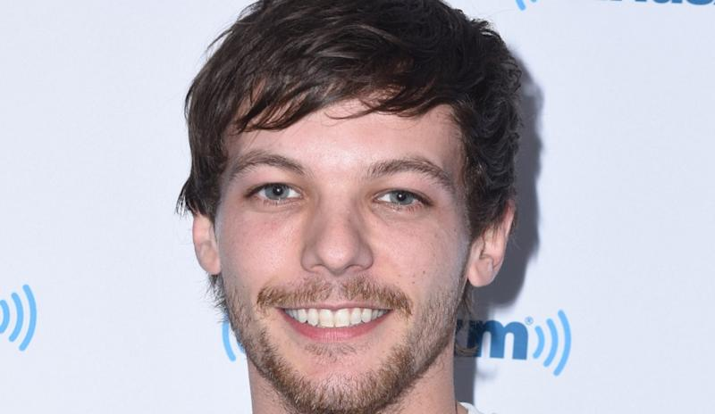 louis tomlinson arrested at lax after fight with paparazzi