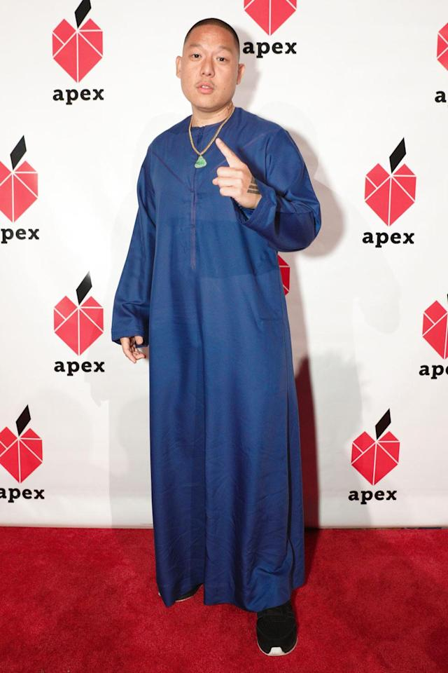 <p>Chef, restaurateur, and creator of <em>Fresh Off the Boat</em>, attends the gala in a long-sleeved blue smock. (Photo: BFA/Courtesy of Apex for Youth) </p>