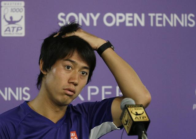 Kei Nishikori, of Japan, listens to a question at a news conference after he withdrew from his semifinal match against Novak Djokovic due to a left groin injury at the Sony Open tennis tournament, Friday, March 28, 2014, in Key Biscayne, Fla. (AP Photo/Lynne Sladky)