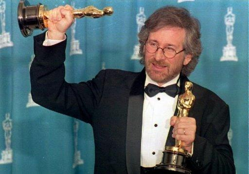 """Steven Spielberg, seen here with two Oscars in Los Angeles, California, during the 66th Annual Academy Awards ceremony, on March 21, 1994 when he won his first best director award for """"Schindler's List."""" The film, which starred Liam Neeson in the title role, picked up seven Oscars, including the coveted best picture"""