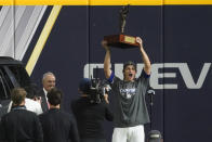 Los Angeles Dodgers shortstop Corey Seager holds up the MVP trophy after defeating the Tampa Bay Rays 3-1 to win the baseball World Series in Game 6 Tuesday, Oct. 27, 2020, in Arlington, Texas. (AP Photo/Tony Gutierrez)