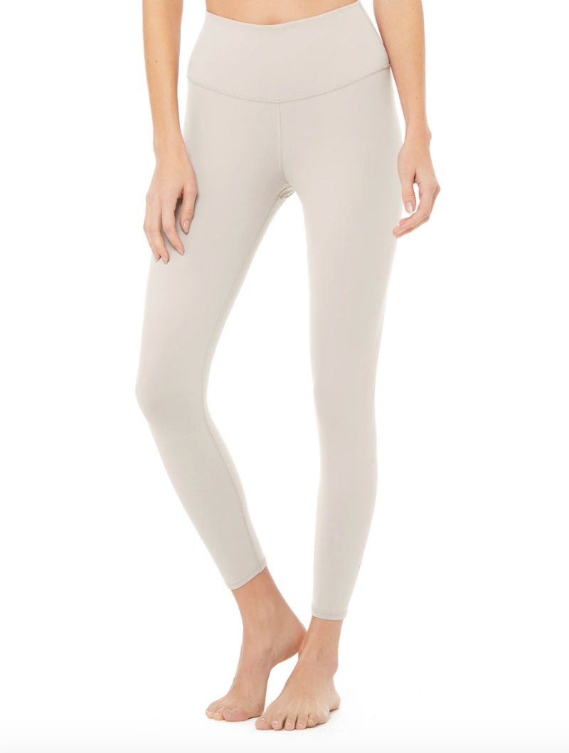 The 7/8 High Waist Yoga Legging in Bone by Alo Yoga.