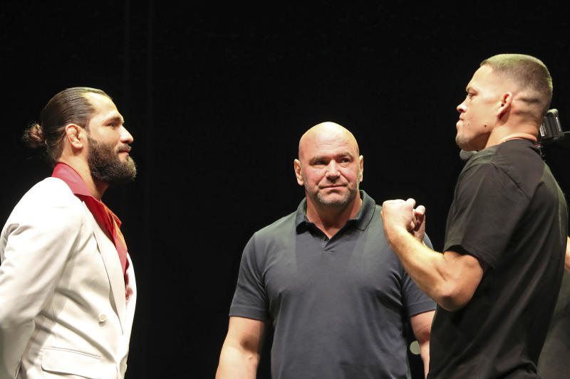 Jorge Masvidal, left, squares off with Nate Diaz at a news conference for the UFC 244 mixed martial arts event, Thursday, Sept. 19, 2019, in New York. Masvidal is scheduled to fight Diaz Saturday, November 2 at Madison Square Garden. (AP Photo/Gregory Payan)
