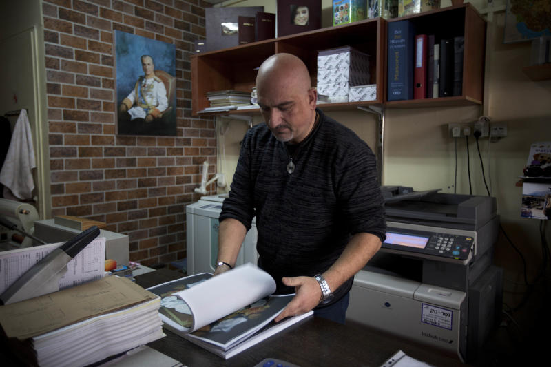 In this photograph made on Sunday, Feb. 12, 2012, Kamal Penhasi, the Iranian-born editor of Shahyad, the only Persian-language magazine published in Israel, works at his print house In the israeli town of Holon. There are an estimated 250,000 Jews of Iranian descent in Israel. (AP Photo/Oded Balilty)