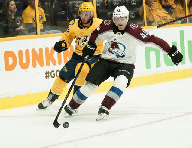 Colorado Avalanche defenseman Samuel Girard (49) carries the puck as Nashville Predators center Colton Sissons (10) chases during the second period in Game 5 of an NHL hockey first-round playoff series Friday, April 20, 2018, in Nashville, Tenn. (AP Photo/Sanford Myers)