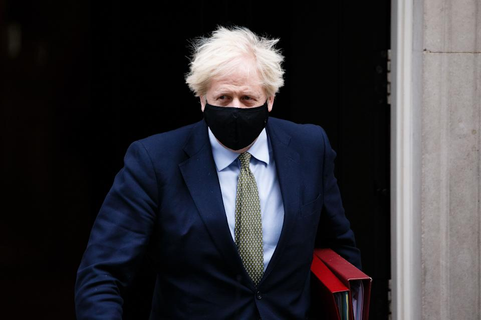British Prime Minister Boris Johnson leaves 10 Downing Street wearing a face mask on his way to Prime Minister's Questions (PMQs) at the House of Commons in London, England, on October 14, 2020. (Photo by David Cliff/NurPhoto via Getty Images) (Photo: NurPhoto via Getty Images)