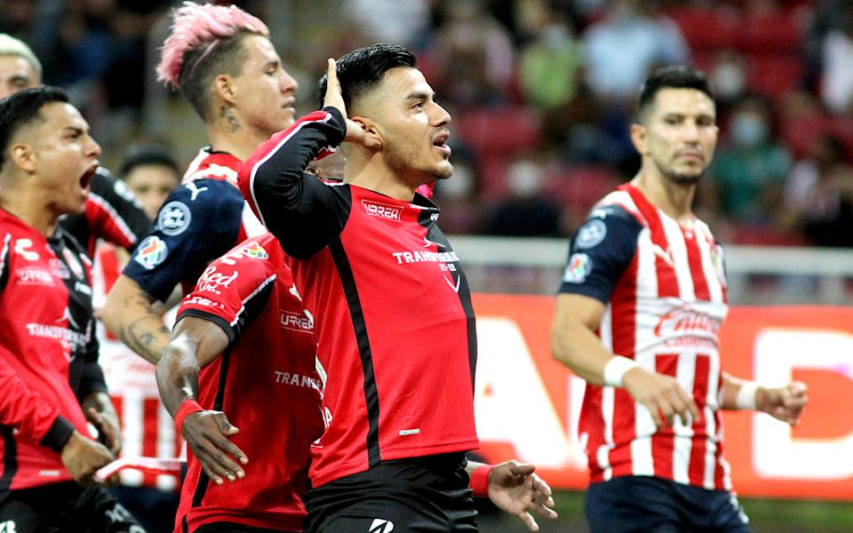 Aldo Rocha (C) of Atlas celebrates with teammates after scoring against Guadalajara during their Mexican Apertura tournament football match, at the Akron stadium, in Guadalajara, Jalisco State, Mexico, on October 2, 2021. (Photo by Ulises Ruiz / AFP) (Photo by ULISES RUIZ/AFP via Getty Images)