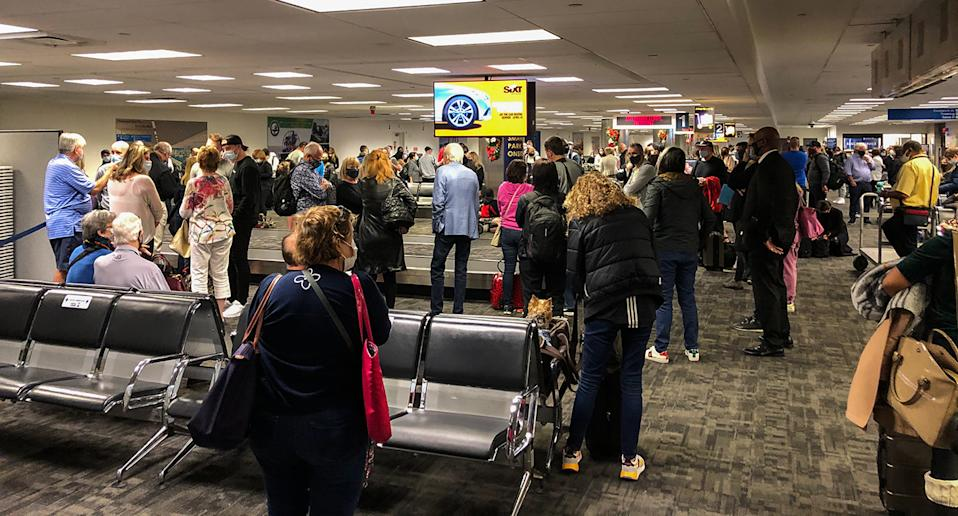 Millions of US residents are travelling ahead of Christmas despite repeated warnings to stay home. Source: AP