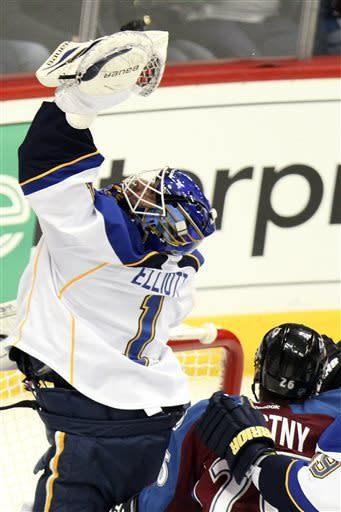 St. Louis Blues goalie Brian Elliott (1) grabs  the puck above the net against the Colorado Avalanche during the first period of an NHL hockey game, Sunday, April 21, 2013, in Denver. (AP Photo/Barry Gutierrez)