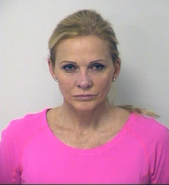 This undated booking photo provided by the DFW Airport Police shows 51-year-old Shemane Ann Nugent, the wife of musician Ted Nugent. Dallas/Fort Worth International Airport confirmed that 51-year-old Nugent was taken into custody Thursday, Aug. 29, 2013, after a handgun was found in her carry-on luggage at an airport security checkpoint. (AP Photo/DFW Airport Police)
