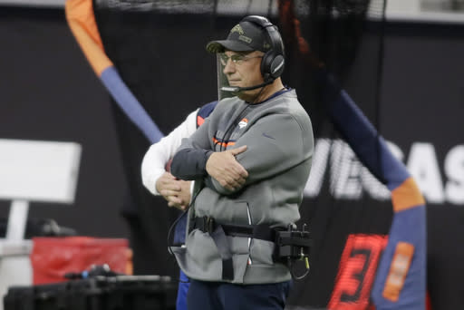Denver Broncos head coach Vic Fangio watches from the sideline during the first half of an NFL football game against the Las Vegas Raiders, Sunday, Nov. 15, 2020, in Las Vegas. (AP Photo/Isaac Brekken)