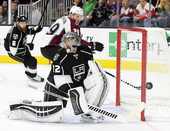 LAS VEGAS, NV - OCTOBER 08: Goaltender Jonathan Quick #32 of the Los Angeles Kings blocks a shot by Nathan MacKinnon #29 of the Colorado Avalanche during their preseason game at T-Mobile Arena on October 8, 2016 in Las Vegas, Nevada. Colorado won 2-1 in overtime. (Photo by Ethan Miller/Getty Images)
