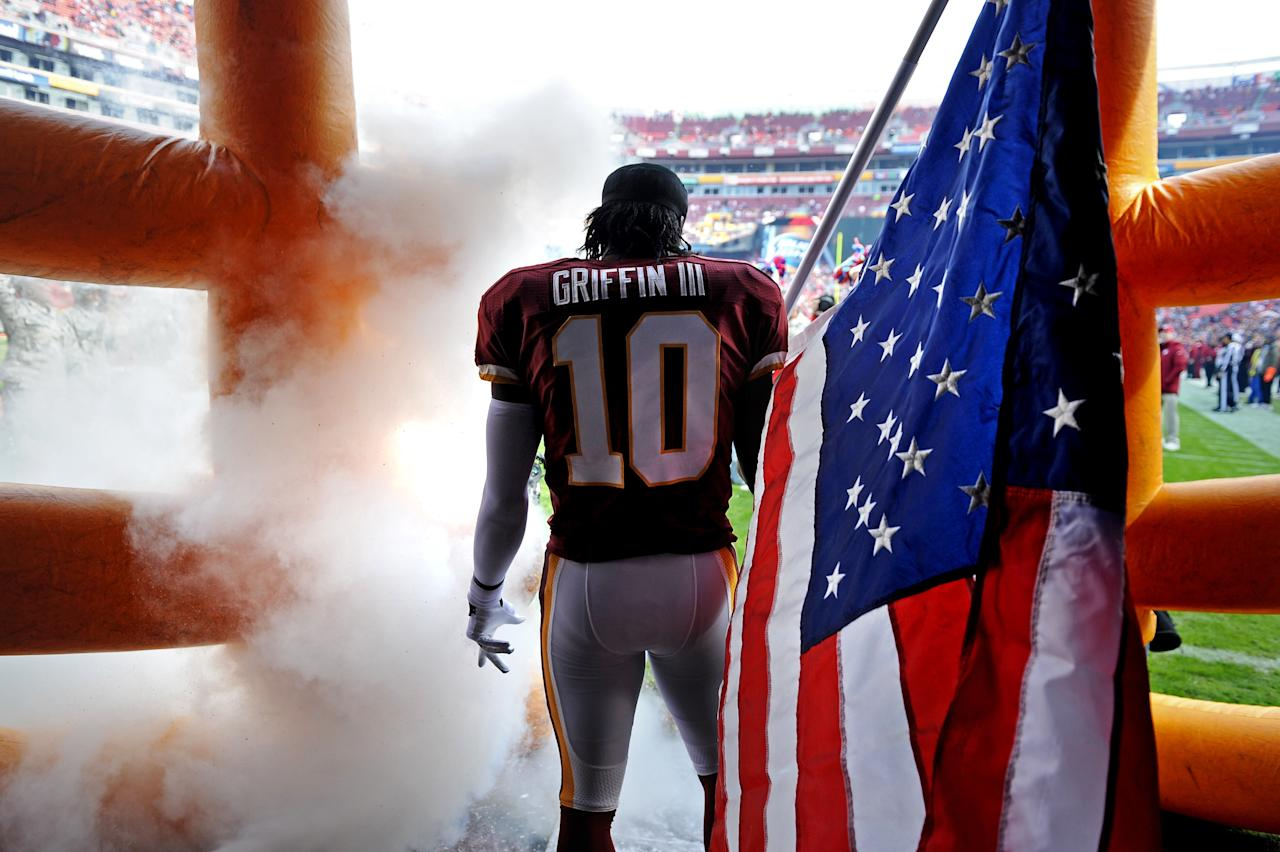 LANDOVER, MD - NOVEMBER 18: Quarterback Robert Griffin III #10 of the Washington Redskins holds an American flag for Military Appreciation before being introduced against the Philadelphia Eagles at FedEx Field on November 18, 2012 in Landover, Maryland. (Photo by Patrick Smith/Getty Images)