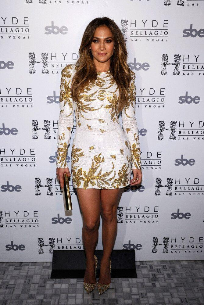 Singer/actress Jennifer Lopez celebrates the launch of her new single, <em>Goin' In</em> wearing a short white and gold dress.