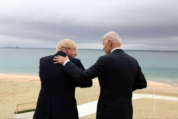PHOTO: British Prime Minister Boris Johnson and President Joe Biden chat on June 11, 2021, ahead of the G7 Leaders' Summit in Carbis Bay, Cornwall, UK. (Andrew Parsons/UPI/Shutterstock)