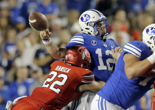 "Utah defensive back Chase Hansen (22) hits BYU quarterback <a class=""link rapid-noclick-resp"" href=""/ncaaf/players/226918/"" data-ylk=""slk:Tanner Mangum"">Tanner Mangum</a> (12) in the first half during an NCAA college football game Saturday, Sept. 9, 2017, in Provo, Utah. (AP Photo/Rick Bowmer)"
