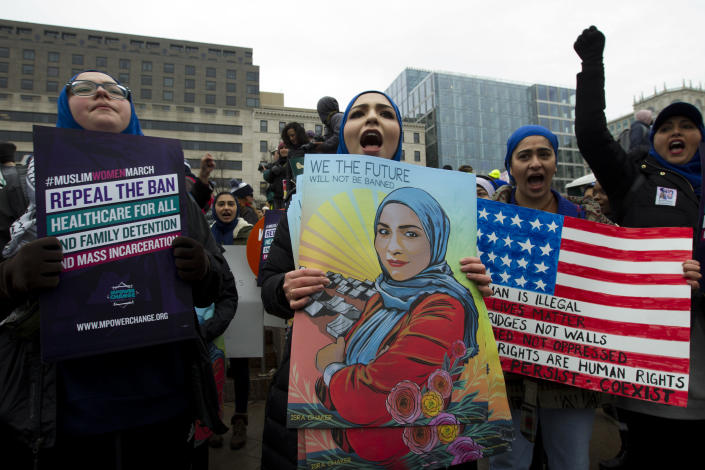 A group hold up signs at freedom plaza during the women's march in Washington on Saturday, Jan. 19, 2019. (Photo/Jose Luis Magana/AP)