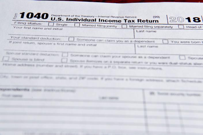 Many Americans saw modest increases in their paychecks throughout the year, but didn't notice. (AP Photo/Keith Srakocic)