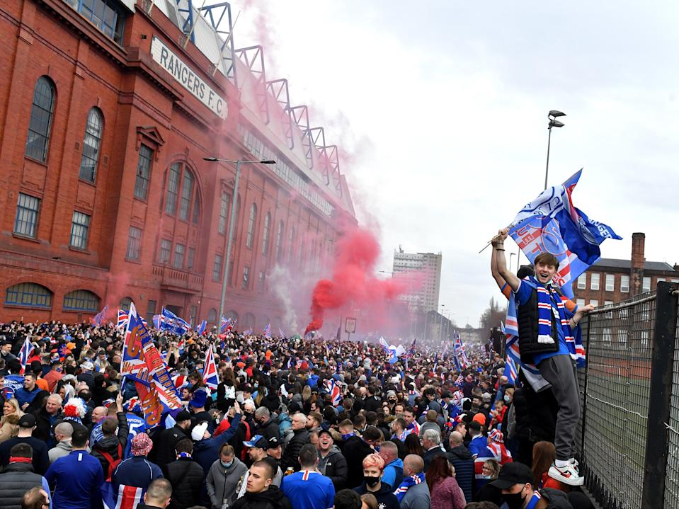 Rangers fans gather to celebrate at the club's Ibrox Stadium (Getty Images)