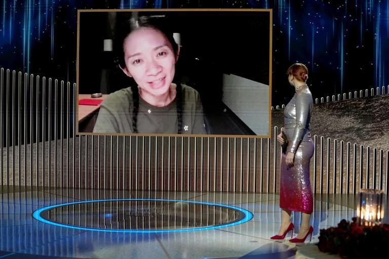 """Chloe Zhao (on screen) made history at the Golden Globes as her film """"Nomadland"""" was the first by a female director to win the top best drama film prize; she also won for best director"""