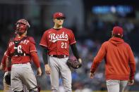 Cincinnati Reds manager David Bell, right, arrives on the mound to remove starting pitcher Jeff Hoffman (23) from the baseball game as Reds catcher Tucker Barnhart stands near the mound during the fifth inning against the Arizona Diamondbacks on Saturday, April 10, 2021, in Phoenix. (AP Photo/Ross D. Franklin)