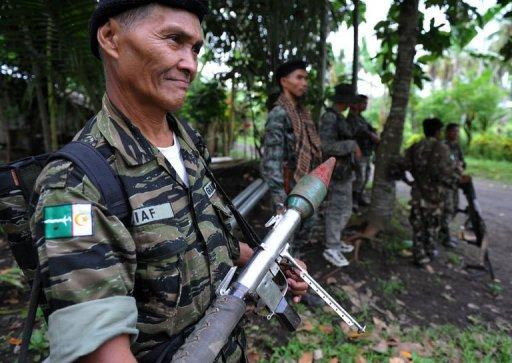 Members of the southern Philippine rebel group, the Moro Islamic Liberation Front (MILF), at Camp Darapanan