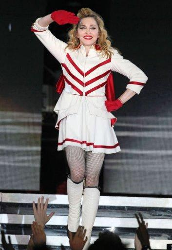 US singer Madonna performs during her concert at Olympic Hall in Moscow. The pop icon said Tuesday at her Moscow concert that she prayed for the freedom of the three members of the Pussy Riot protest band who face three years in jail for insulting Vladimir Putin in a church