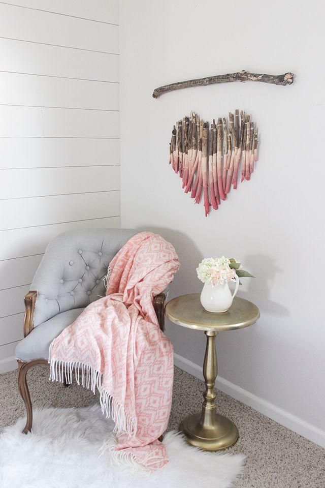 """<p>Get your kids involved in making this rustic décor by challenging them to collect as many twigs and branches from the backyard as possible. </p><p><em><a href=""""https://www.shadesofblueinteriors.com/diy-branch-heart-wall-art/"""" rel=""""nofollow noopener"""" target=""""_blank"""" data-ylk=""""slk:Get the tutorial at Shades of Blue Interiors »"""" class=""""link rapid-noclick-resp"""">Get the tutorial at Shades of Blue Interiors »</a></em></p>"""