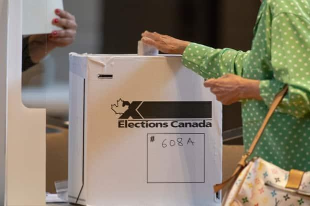 A voter casts her ballot at an advance polling station in Toronto on Sept. 10, 2021. Canadians are being told that voting will likely take longer than expected on Monday. (Evan Mitsui/CBC - image credit)