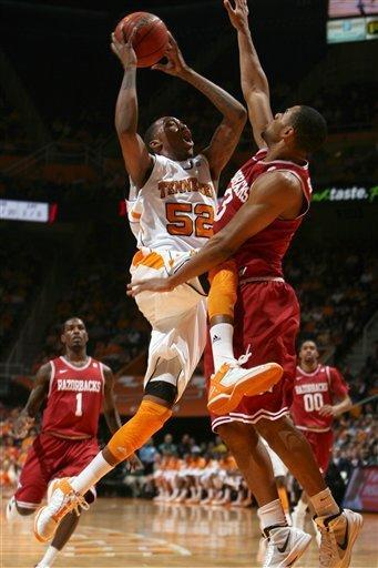 Tennessee forward Jordan McRae (52) shoots over Arkansas guard Rickey Scott (3) during the first half of an NCAA college basketball game at Thompson-Boling Arena in Knoxville, Tenn., Wednesday, Feb. 15, 2012. (AP Photo/Knoxville News Sentinel, Adam Brimer)