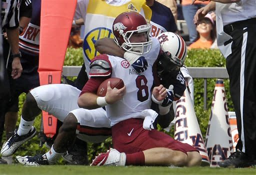 Auburn defender Dee Ford tackles Arkansas quarterback Tyer Wilson short of the goal line forcing a field goal attempt during the first half of an NCAA college football game on Saturday, Oct. 6, 2012 in Auburn, Ala.(AP Photo/Todd J. Van Emst)