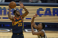 Golden State Warriors forward Andrew Wiggins (22) shoots against San Antonio Spurs guard Devin Vassell during the first half of an NBA basketball game in San Francisco, Wednesday, Jan. 20, 2021. (AP Photo/Jeff Chiu)