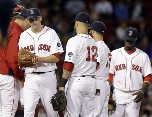 Boston Red Sox starting pitcher Allen Webster, far left, is taken out of the baseball game against the Minnesota Twins during the second inning at Fenway Park in Boston, Wednesday, May 8, 2013. (AP Photo/Elise Amendola)