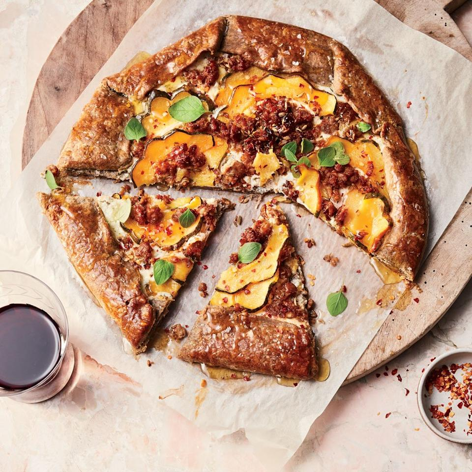 """<p>This pizza-like crostata comes from sommelier Dana Frank and recipe developer Andrea Slonecker's book, <em>Wine Food: New Adventures in Drinking and Cooking</em>, and is easy enough for a weeknight, but impressive enough for a dinner party.</p> <p> <a href=""""https://www.foodandwine.com/recipes/delicata-squash-and-sausage-crostata-ricotta-and-honey"""">Go to Recipe</a></p>"""