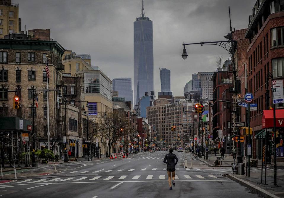 This photo from Saturday March 28, 2020, shows a lone jogger on a deserted Manhattan street after citywide after COVID-19 pandemic restrictions in New York. The chaos unleashed in 2020, amid the coronavirus pandemic, has created space for different voices to speak, for different conversations to be had and for different questions to be asked. (AP Photo/Bebeto Matthews, File)