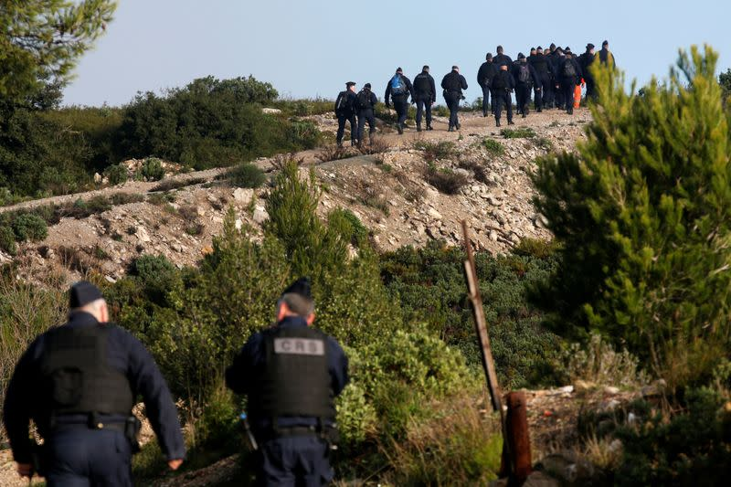 French police secure the area around the site where a helicopter from the civil security services crashed near Marseille