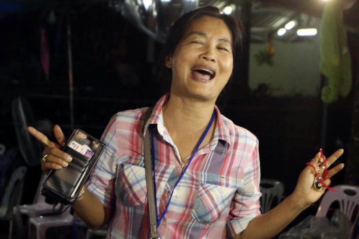 <p>A relative celebrates after 12 boys and their soccer coach were found alive in a cave complex in Mae Sai, Chiang Rai Province, northern Thailand, on July 2, 2018. Rescuers located 12 boys and their soccer coach alive deep inside the partially flooded cave more than a week after they went missing. (Photo: Sakchai Lalit/AP) </p>