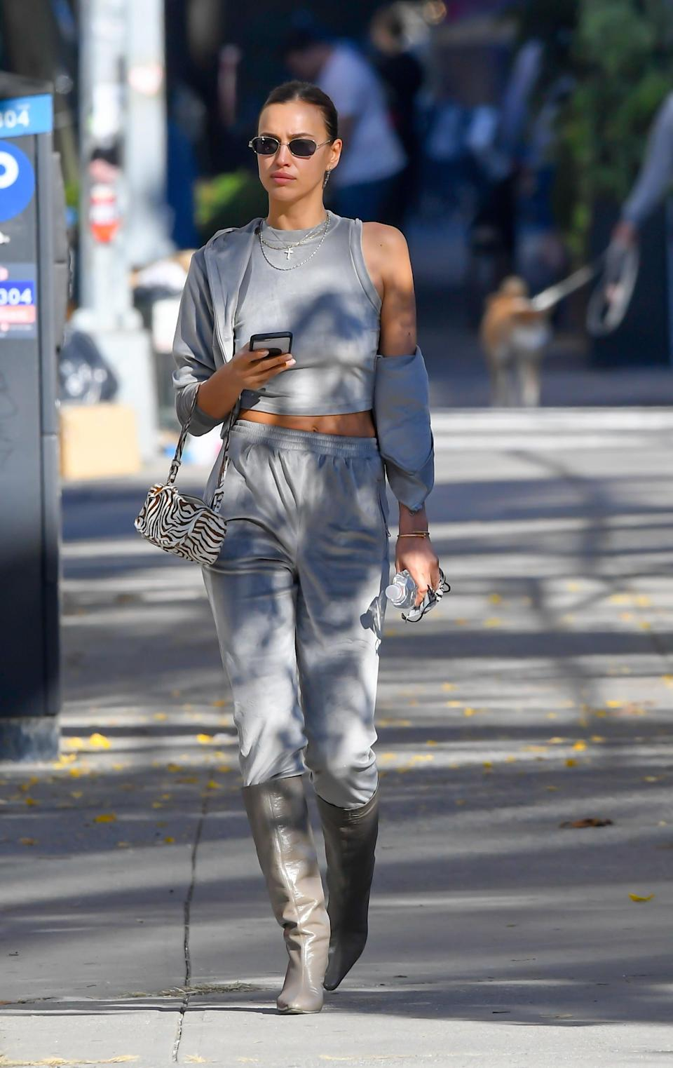 <p>Who else would pair a comfy velour sweatsuit with heeled boots?</p>